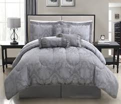 elegant bedroom with king size bedding on piece celina gray