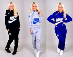 nike outfits for women. nike sweat suit, this model has a bad tan btw outfits for women