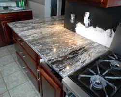 rocky mountain granite on dark wood cabinets kitchen countertops
