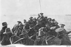 the anzac day tradition the n war memorial a view looking aft of lifeboat carrying unidentified men of the n 1st divisional signal company as they are towed towards anzac cove on the day of
