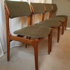 available at funkyretrocool in seattle four erik buch model 49 dining chairs for