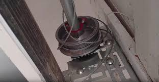How To Open Garage Doors With Broken Cable | Red Deer Windows & Doors