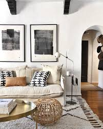 a white and black tassel rug gives this space extra warmth and visual interest