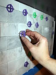 remove spacers and clean tile