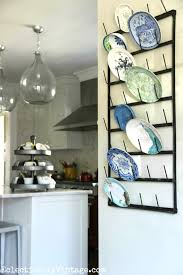 what a cool idea use a bottle drying rack as plate display plus see