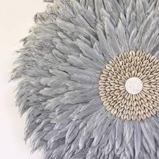 grey feather juju hat wall hanging