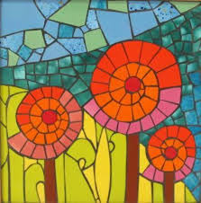 learn how to make a small stained glass mosaic on a decorative stepping stone for your garden or walkway using colored glass glue and cement