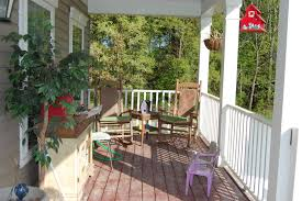 exterior: Perfect Decor Of Rustic Front Porches With Mini Table Between  Rocking Arm Chairs Near