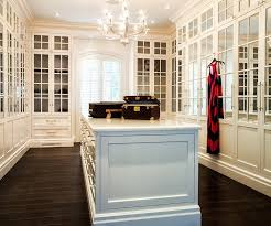 walk in closet with mirrored cabinet doors