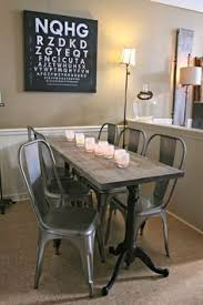 dining table and benches made out of metal and reclaimed wood for that modern industrial look