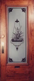etched glass hanging basket design in an antique door