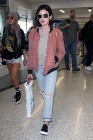 lucy hale s airport style is a comfy blush pink er and boyfriend jeans
