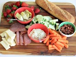 cutting board with food. Pulling Ingredients From The Pantry, Fridge And Freezer, Then Loading Them Onto Cutting Board Is Equal Parts Handy With Food N
