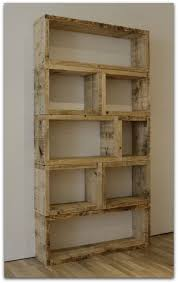 {an open bookshelf, made from recycled wood. simple and classy.}