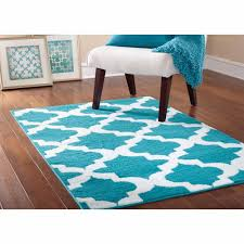 blue area rugs on dark pergo flooring with white baseboard and parsons chair plus also turquoise rug teal brown large pink gray red black cream by