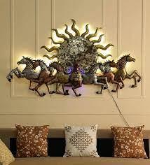 metal running horse behind sun in