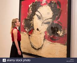 london uk 9 june 2016 a gallery employee looks at the painting odalisca 2016 marlborough fine art present the exhibition manolo valdes recent work
