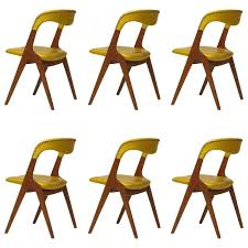 johannes andersen yellow leather dining chairs for