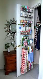 Gift Wrap Organization on the back of a door. Elfa container store.