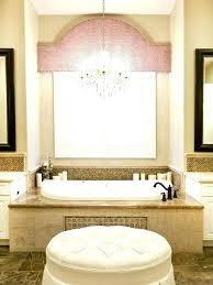 chandelier over tub chandelier over bathtub mid sized elegant master beige tile and stone marble floor drop in height chandelier over bathtub chandelier