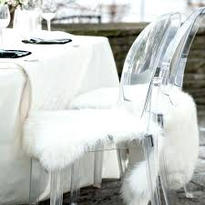 white fur chair cover on a ghost next to table with tablecloth target white fur chair