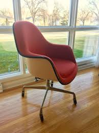 fiberglass shell chairs. herman miller eames loose cushion fiberglass swivel shell chair chairs