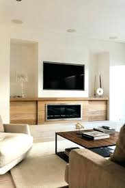 tv on wall next to fireplace built in television wall wall units astonishing inbuilt cabinets built