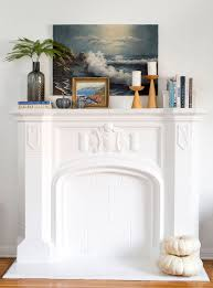 love this fireplace from the inspired room the leaning art makes a statement while the tall vase adds height to the right side of the mantel