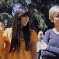 A cowboy's work is never done (sonny & cher). Great Outfits In Fashion History Sonny And Cher In Coordinating Saffron Looks Fashionista