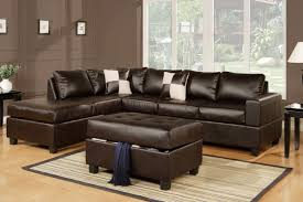 how to decorate living room with dark brown l shaped leather sofa complete with square padded table as storage complete with rug on the light brown floor can you paint leather furniture