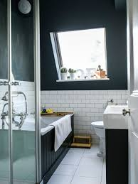 Transitional drop-in bathtub photo in London with an integrated sink, black  cabinets and