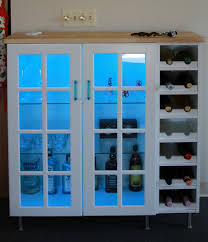 Akurum wall cabinet + Perfekt wine shelf and Lidi glass doors.