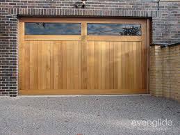 timber sectional garage door with acrylic windows