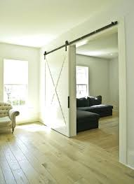 hanging sliding door hardware hanging sliding door living room farmhouse with barn door hardware baseboards image hanging sliding door