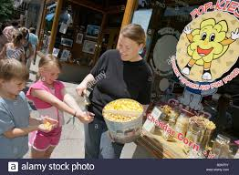 michigan traverse city front street shopping w girl boy pop michigan traverse city front street shopping w girl boy pop kies gourmet popcorn sample s clerk food snack business