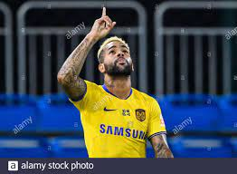 Brazilian football player Alex Teixeira of Jiangsu Suning F.C. celebrates  after scoring a goal during the fourth -round match of 2020 Chinese Super  League (CSL) against Guangzhou R&F F.C., Dalian city, northeast