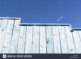 Blue Fence Designs Old Blue Wooden Wall And Fence Set Against A Blue Sky