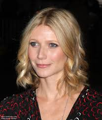 photo of gwyneth paltrow with her short hair styled in soft spirals