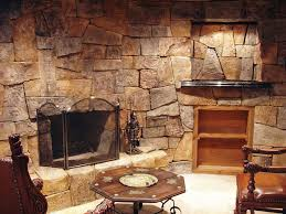 interesting living room decoration with beautiful rock stone wall fireplace combine hexagon wooden coffee table plus carving wooden armchair