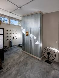 industrial metal wall art entry with white walls exposed