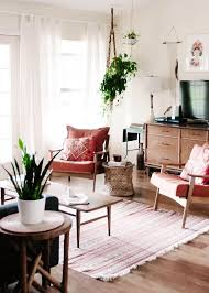 Love This Midcentury Modern Living Room With Vintage Peg Leg Coffee Table  And Arm Chairs, White Ceramic Accents, Pretty Pink Upholstery, And Tons Of  Hanging ...