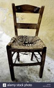 old wooden chair. Exellent Chair Old Wooden Chair With Wicker Seat Worn Out Crete Greece Europe Inside Wooden Chair N