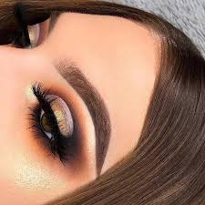 awesome golden smokey eye makeup with a pop of gold
