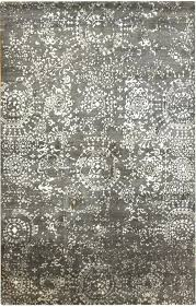 silver oriental rug by grey couch rugs