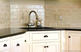 beige subway tile backsplash kitchen idea of the day creamy subway tile behind the sink more ideas beige subway tile backsplash with white cabinets