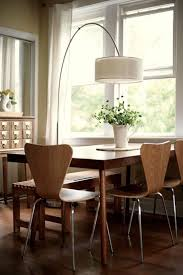 An Arc Lamp Illuminates The Dining Table Dreamy Home Pinterest Inspiration Lamp For Dining Room