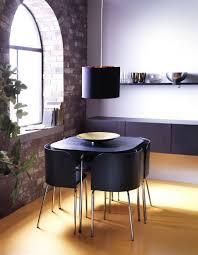 ikea fan favorite fusion dining table and chairs the chair backs are shaped to fit the corners of the table to save e when the chairs are pushed in
