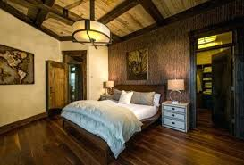 chandelier in bedroom a custom drum with steel details adds an understated touch of masculinity to
