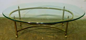 Oval Glass Top Coffee Table With Brass Frame And Wheels For Contemporary  Living Room Spaces Ideas