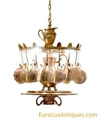 this delightful chandelier is a perfectly amusing piece for any cottage decor or for anyone who takes her tea with a lump of humor